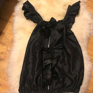 Ruffled black top with zipper at center